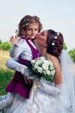 Wundervolles junges Verlobtes und schönes kleines Mädchen Stockfotografie