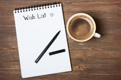 Wunschlistewort auf einem Notizbuch Lizenzfreie Stockbilder