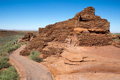 Wupatki National Monument Ruins. FLAGSTAFF, ARIZONA - JUNE 14, 2016: Tourists walk through ruins built by Native American Pueblo Indians at Wupatki National Royalty Free Stock Photo