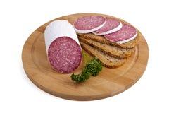 Wurst - Salami, Brot, Petersilie Lizenzfreie Stockfotografie