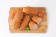 Wurst sausages. Raw wurst sausages on wooden cutting board royalty free stock photos