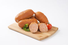 Wurst sausages. Raw wurst sausages on wooden cutting board stock photo