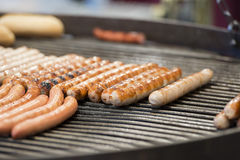 Wurstel on barbecue Stock Photos