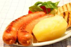 Wurstel and potato Stock Photography