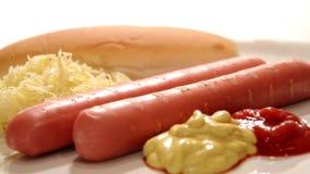Wurstel, sauerkraut and sauces Stock Photo