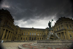 Wurzburg palace and clouds. Fa�ade of Wurzburg residence palace and dark clouds stock images