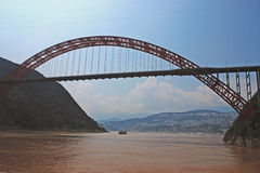 Wushan bridge. The Yangtze gorges wushan very risk, bridging between two mountains, like a rainbow across the Yangtze river Stock Images
