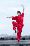 Wushoo man in red practice martial art. Shaolin warriors wushoo man in red practice martial art outdoor. Kung fu Stock Photography
