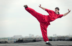 Wushoo man in red practice martial art Royalty Free Stock Photos