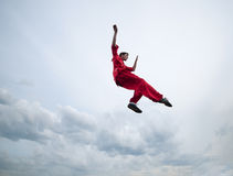 Wushoo man in red practice martial art Royalty Free Stock Image
