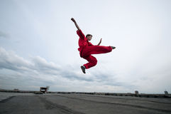 Wushoo man in red practice martial art Stock Image