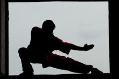 Wushoo man in red practice martial art. Shaolin warriors wushoo man silhouette practice martial art outdoor. Kung fu Stock Images