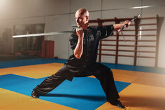 Wushu master training with sword, martial arts Stock Images