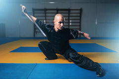 Wushu master training with sword, martial arts Stock Photos