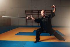 Wushu master training with sword, martial arts Stock Photos