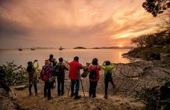Photographers take Taihu sunset at the Turtle Head Islet Park. stock image