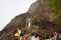 Wuyishan China Visitors. Chinese tourists climbing up the stone steps up to the top of the Mount Wuyi Scenic area in Fujian province China royalty free stock photos