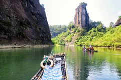 Wuyishan nine bend river china. Bamboo rafting near the rock formations lining the nine bend river or Jiuxi in Wuyishan or Mount wuyi scenic area in Wuyi China royalty free stock photo