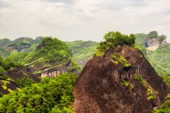 Wuyishan scenic area landscape china. A rocky cliff and the mountains and hills of Wuyishan scenic area in Fujian province China stock images