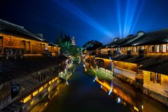Wuzhen, Zhejiang, China night scene. Yellow lights, blue sky. ancient architecture stock image