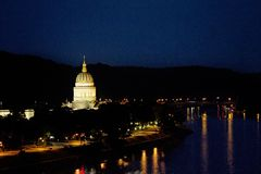 WV State Capitol Building at night. West Virginia State Capitol building along the Kanawha River at night. Charleston, WV stock photos