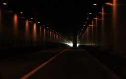 WV-tunnel with lights. Tunnel through the mountains in WV with the tunnel lights on and a small ray of light at the end royalty free stock photos