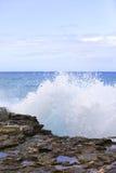 Wves crashing on the rocks. Image of waves crashing on the rocks at Kaena Point State Park Royalty Free Stock Photos