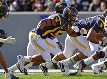WVU defensive line rushing to block kick Stock Photo
