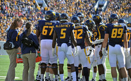 WVU football - offense huddle Royalty Free Stock Photography
