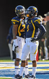 WVU football teammates. MORGANTOWN, WV - NOVEMBER 5: WVU football players Tavon Austin (r) and Brodrick Jenkins (l) talk on the field prior to the football game Royalty Free Stock Image