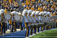 WVU Pride of West Virginia marching band. MORGANTOWN, WV - NOVEMBER 5: The Pride of West Virginia marching band's drum line makes it's way onto the field prior Stock Photography