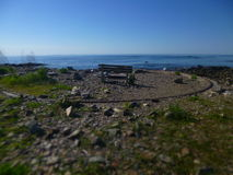 WW2 Bench. Lonely bench on the coast at Odiorne Pointe stock photography