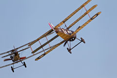 WW1 fighter aircraft. BIGGLESWADE, UK - JULY 6: A WW1 Sopwith triplane follows a Bristol fighter along the Old Warden aerodrome in preparation for their landing Stock Images