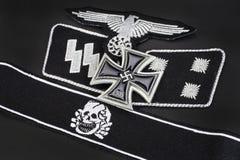 WW2 German Waffen-SS military insignia with Iron Cross award. Background Stock Photography
