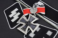 WW2 German Waffen-SS military insignia with Iron Cross award. Background Stock Image