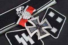 WW2 German Waffen-SS military insignia with Iron Cross award. Background Royalty Free Stock Photos