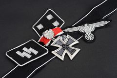 WW2 German Waffen-SS military insignia with Iron Cross award. Background Royalty Free Stock Images