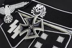WW2 German Waffen-SS military insignia with Iron Cross award. Background Royalty Free Stock Image