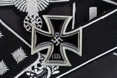 WW2 German Waffen-SS military insignia with Iron Cross award. Background Stock Photos