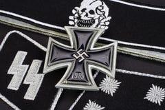 WW2 German Waffen-SS military insignia with Iron Cross award. Background Stock Photo
