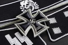 WW2 German Waffen-SS military insignia with Iron Cross award. On black background Royalty Free Stock Photography