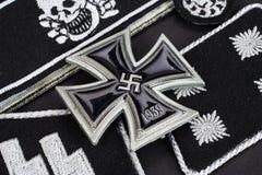 WW2 German Waffen-SS military insignia with Iron Cross award. On black background Stock Image