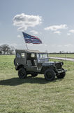 WW2 Jeep alone flying the stars and stripes. Royalty Free Stock Photos