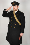 WW11 koninklijke Marineambtenaar in overjas stock afbeeldingen