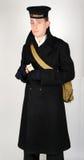WW11 koninklijke Marinezeeman in overjas Stock Fotografie