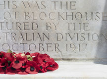 WW1 Memorial to Soldiers at Tyne Cot. CWGC war grave with poppy reef and floral tributes Royalty Free Stock Images