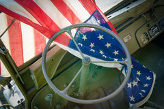 Ww2 military vehicle with American flag. A ww2 military vehicle, jeep,with American flag royalty free stock image