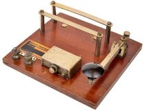Ww2 morse code practice set. World war two era morse code practice buzzer, plated brass components on a wooden base. Sets such as this would have been used to Stock Image
