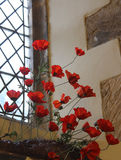 WW1 poppies in church window Royalty Free Stock Photos