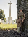 WW1 soldier US at war cemetary in france or Belgium. Soldier at war cemetery with cross in background 1914 - 1918 Royalty Free Stock Photos